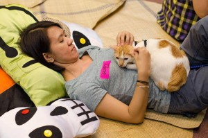 CARA Volunteer Glady Rosales with Guyito, a rescued Puspin