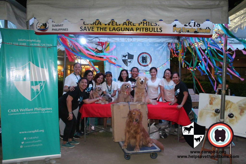 Volunteers and their furry assistants at the CARA Welfare Philippines booth at Pet Summit 2018